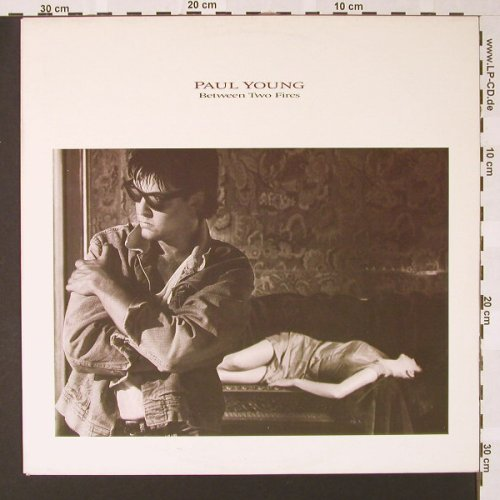 Young,Paul: Between Two Fires, CBS(450150 1), NL, 1986 - LP - E7252 - 5,00 Euro